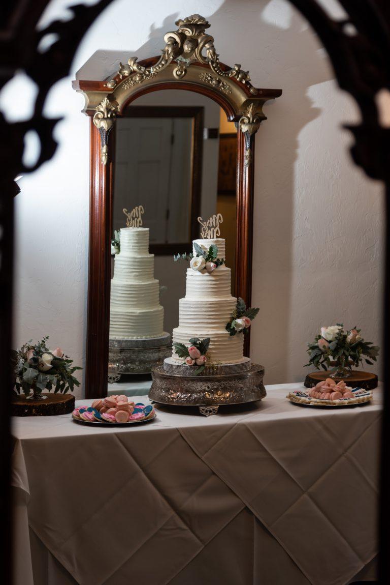 Wedding cake mirror reflection at sweetwater branch inn gainesville florida