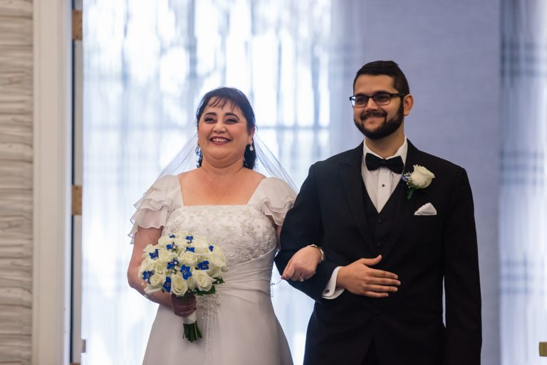 Bride and Son walk down the aisle at the wedding ceremony at the Hilton Hotel, University of Florida Gainesville