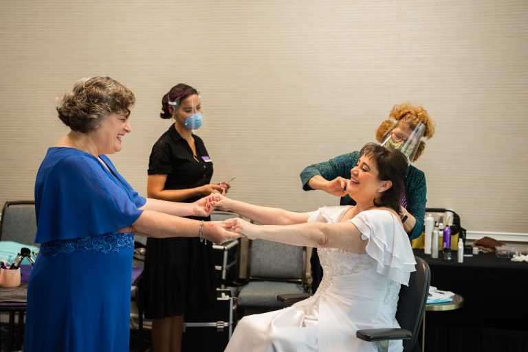 Bride and her Maid of Honor celebrating during her getting ready