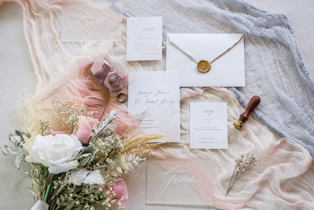 flat lay wedding decorations, invitations, flowers, rings