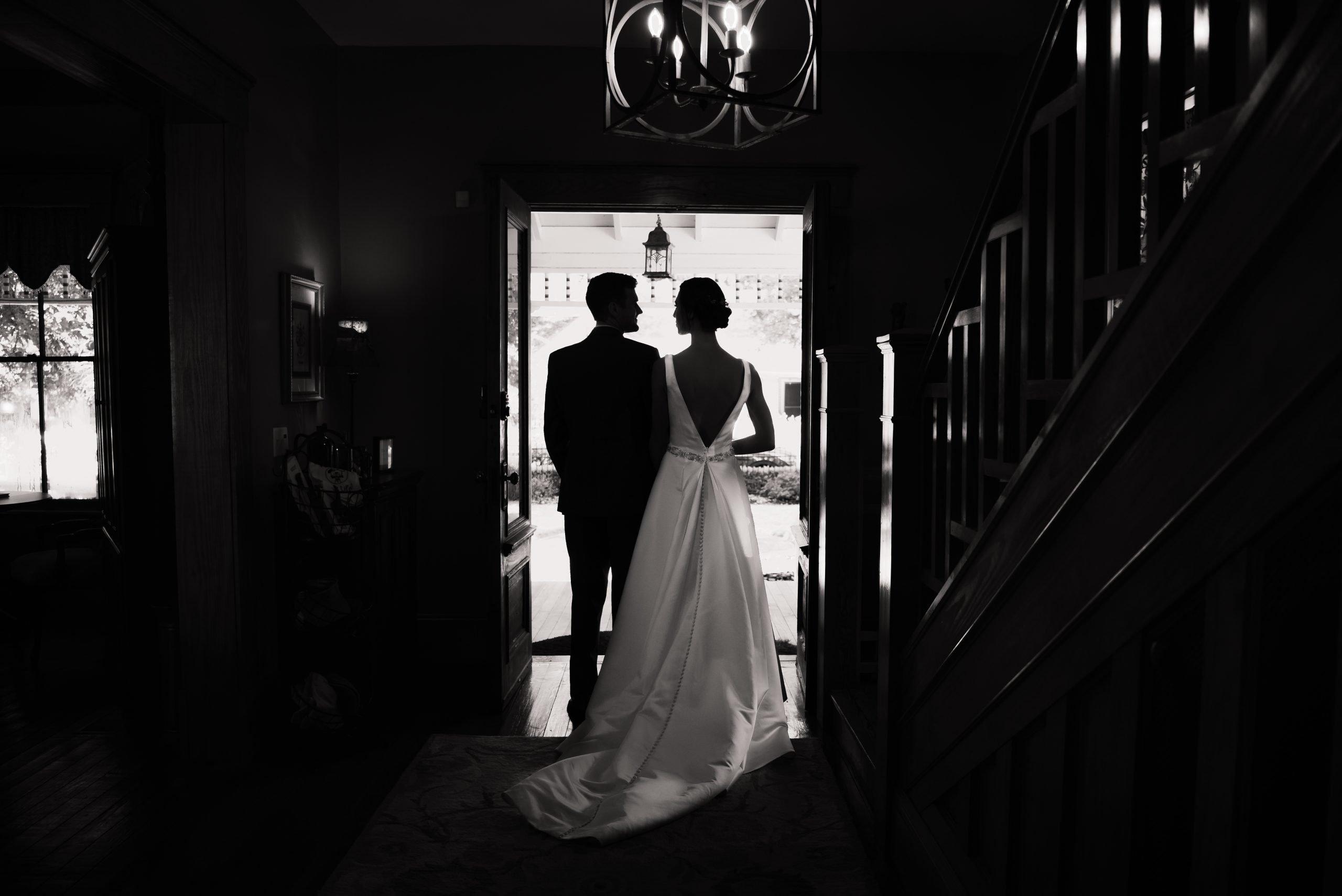 bride and groom in doorway at the laurel oaks inn on their wedding day