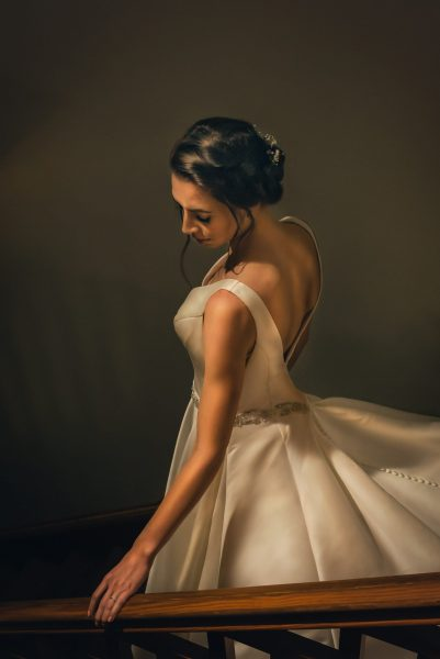 portrait of bride on staircase on her wedding day